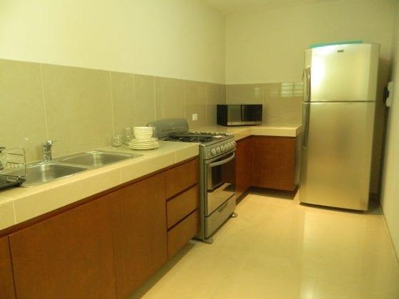 Departamento con modernos muebles y acabados for Muebles departamento
